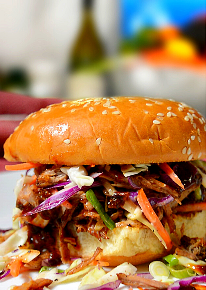 Ancho pulled pork sandwich on a plate with a red linen